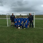 TIBS junior football team in their Main-Tel sponsored strip.