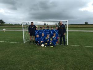 TIBS junior football team in their Main-Tel sponsored strip.